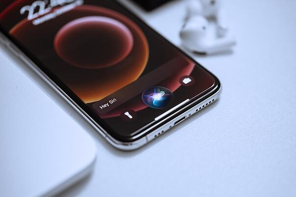 Voice assistant Siri being used on mobile device.